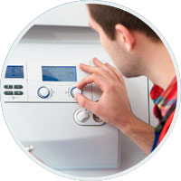 Man installing boiler
