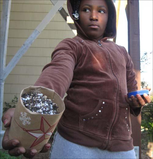Alyssa displays her finished paper pot