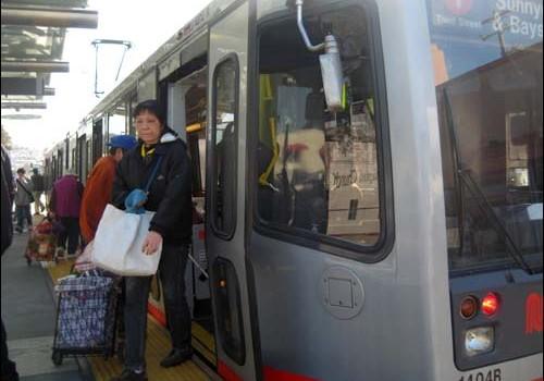 Passengers on Muni's T streetcar line
